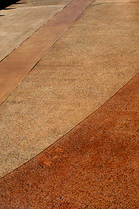 Two complementary colors of water-based stain were sealed with three coats of heavy-duty sealer with a clear synthetic aggregate for slip resistance.