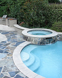 Tom Ralston - Oyster White/Sandstone Color-Texture Combination on a concrete pool surround and hot tub.