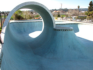 A side view of the full pipe at a skate park in Santa Cruz