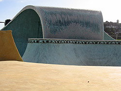 Concrete wave at a skate park was colored with acid-stain