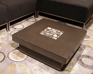 Concrete coffee table with decorative center.