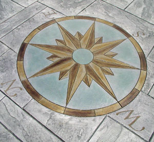 Decorative concrete stamped compass rose
