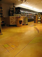 Decorative concrete work done at a 22,000-square-foot Heinen's Supermarket in the Cleveland area. Bonding primers were used to help concrete stick to tile