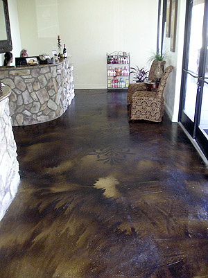 Acid stained concrete floor with designs imprinted into it add depth and dimension.