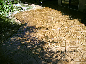 Outdoor concrete patio that has been stamped and stained.