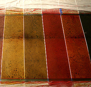 A test slab with four sample colors of a dye, made for the benefit of a client.