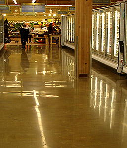 On this project by Seattle-based company Concrete Restoration, the end user desired a cream finish. In order to keep the cream, the floor was finished to to a low flatness level (F(f)), leaving behind a wavy pattern in the existing floor.