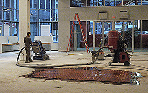 In process shot of the remodeled furniture store. Concrete grinder is used to get the desired effect.