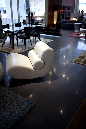 High-end furniture pops on this polished concrete floor.