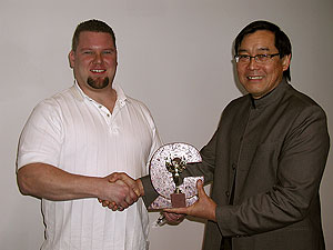 Gregory Mata receives an award from Fu Tung Cheng for excellence in concrete.