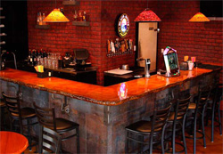 Concrete countertops were installed on the bar to take the decorative concrete makeover to another level.