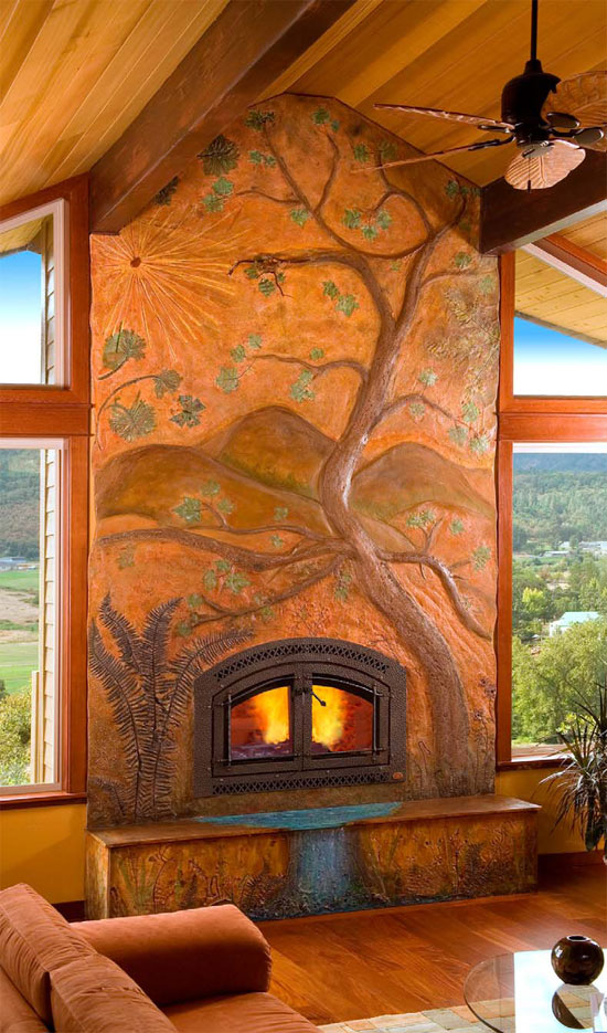 Floor to ceiling concrete fireplace with a tree carved and colored to add an artistic flair to this rustic home.