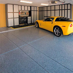 A yellow corvette sits on a newly installed garage floor epoxy system.