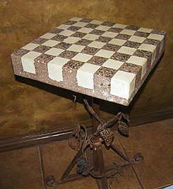 This rotating chess table, made by Ben Ashby of Concrete Encounters as a Christmas gift, was constructed using two colors of concrete poured separately. A terra cotta mix with seeded aggregate was poured first, followed by white concrete. Then, the table was polished to expose the seeded and white aggregates.