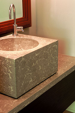 This cube sink and vanity, fabricated by Concrete Concepts and Design, is made from Buddy Rhodes Bone White Concrete Counter Mix, which is specially formulated for making countertops, fireplace surrounds, bathroom vanities, sinks, concrete furniture and other architectural elements.