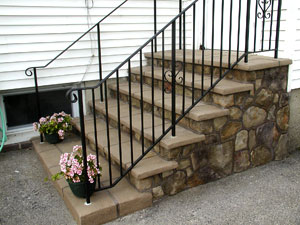 The concrete steps have been restored and look much more clean and safe with this upgrade.