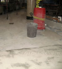The concrete floor before its restoration was complete.