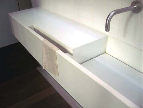 Integral Sink: John Newbold, Newbold Stone Architectural Concrete, Austin, Texas Minimalist white sink with integrated towel holder
