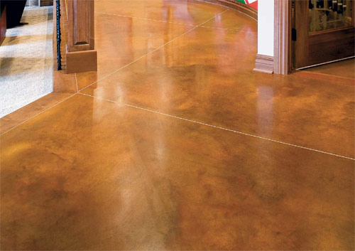 This surface, colored with L.M. Scofield's Lithocrome Chemstain acid stain, has a mottled and irregular appearance that is intended to closely resemble the shadings of nature. The stain allows surface imperfections to become part of the distinctive beauty of the floor.
