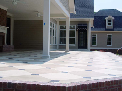 stamped concrete patio outside a hole with brick-like edge made with concrete