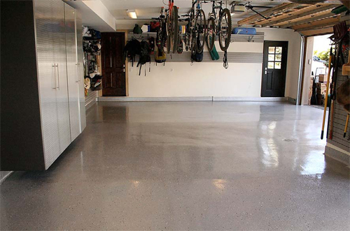 This garage with a metallic finish was installed using a system from One Day Floors that includes polyaspartic technology.