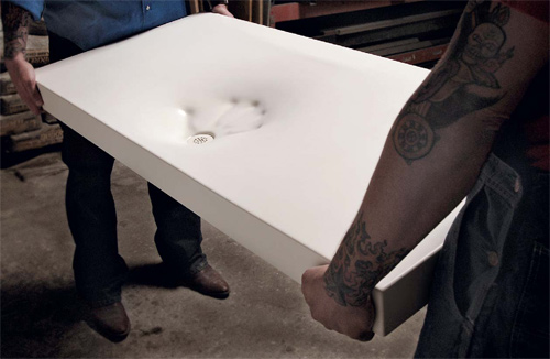 Brandon Gore of Gore Design Co. in Tempe, Ariz., says he's been successfully producing GFRC sinks for the past five years. Seen here is a white GFRC sink he created using a fabric form, which, subsequently, Gore Design started to produce. The company also sells a video showing the process.