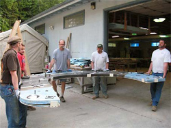Five men show how lightweight concrete countertops can be when reinforced with GFRC.