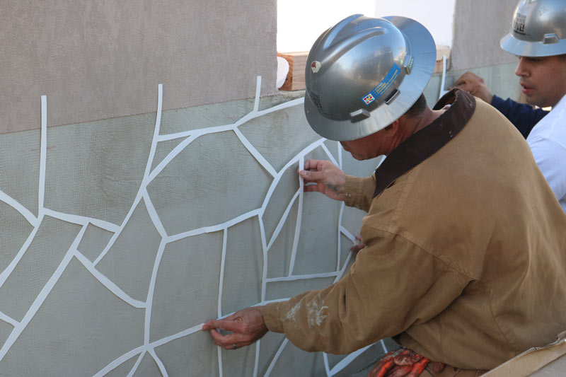 Applying color to the wall at Decorative Concrete Live.