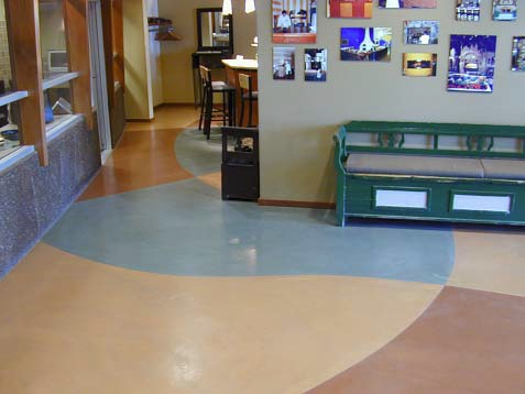 Concrete overlay in multiple colors is placed in a commercial, high-traffic space.