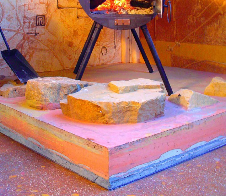 A layered, integrally colored concrete and sandstone hearth in Mike Miller's Concretist studio.