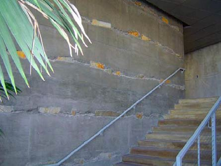 Note quartzite stacked between lifts in this Lithocrete installation by T.B. Penick & Sons Inc., of San Diego. Shimmering silvers and oxidized iron colors in the quartzite play well with the natural gray vertical concrete and the gold-and-rust-patina stained horizontals.