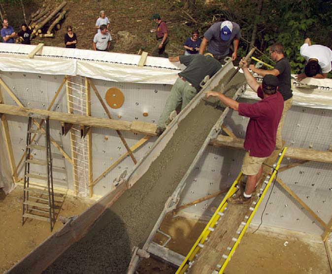"Students place concrete into fabric formwork while building the walls of a guest cabin at the Yestermorrow Design/Build School campus in Warren, Vt., last summer. This year, together with the Norwich University School of Architecture, the school will offer ""Innovations in Fabric Forming With Concrete."" Slated for June 27-July 2, the hands-on class will involve forming and pouring a series of innovative concrete architectural components, with a focus on wall forming."