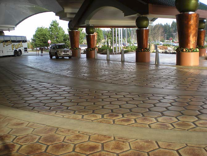 Stamped and stained concrete in a vast hotel entrance creates a visually stunning welcome to hotel guests.