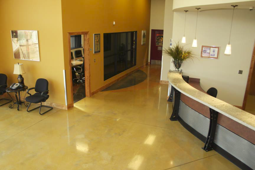 An office space has been dyed with a yellow dye and polished for high-gloss sheen.
