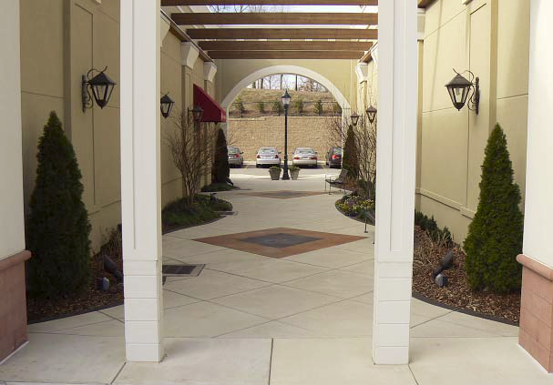 A large courtyard that connects parking lots has been stained and finished with decorative concrete techniques.