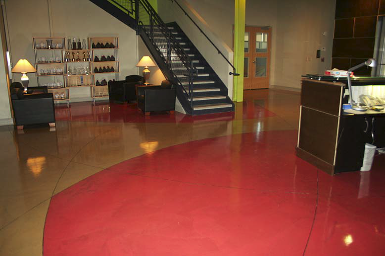 Red and brown concrete dyes were placed on this slab before it was polished.