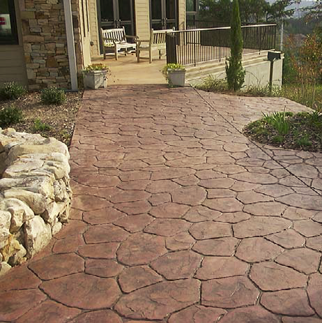 A stamped concrete pattern that serves as a walkway.