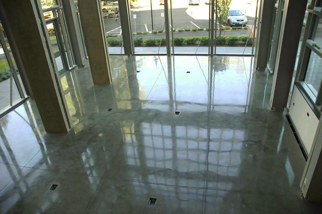Highly-reflective concrete floor that has been polished.