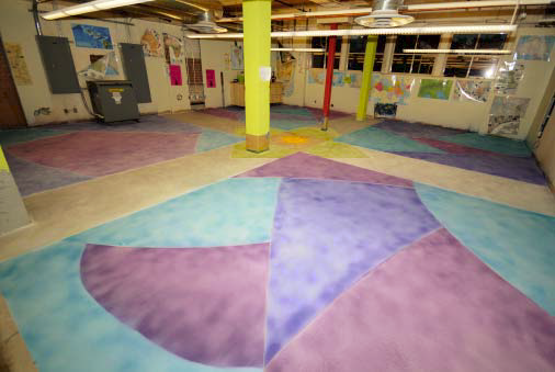 The floor of the staff breakroom was created with geometric patterns and bright colors to bring life to the room