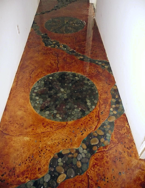 Embedded glass and slate rock were installed in this floor.