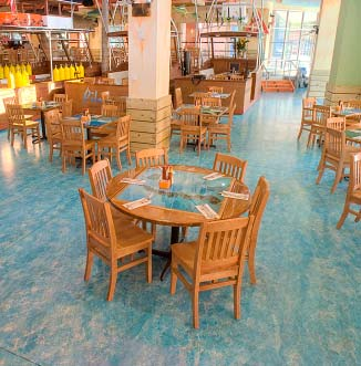 Blue mottle concrete overlay in a busy restaurant dining room.