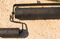 Hand rollers for concrete to make the appearance of a rock salt finish.