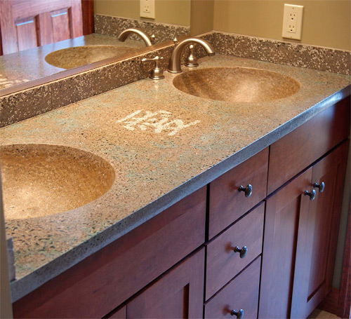 Glow-in-the-dark large sand aggregate from Ambient Glow Technology was hand-seeded between the sinks of this vanity. Photo courtesy of Ambient Glow Technology