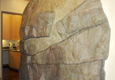 Rock feature greets patients in this dentist office.