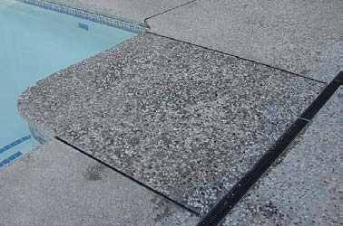 How to clean exposed aggregate concrete around pool