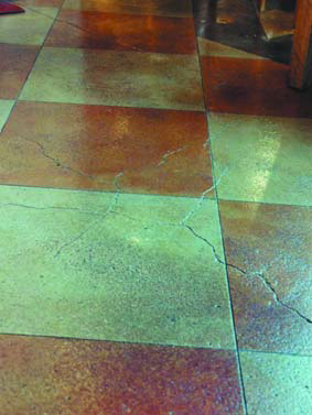 A checkerboard pattern was developed on this aged concrete and the crack was incorporated into the design.