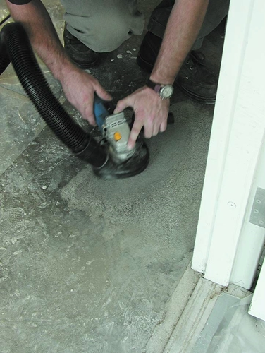 Polishing Concrete with handheld grinder