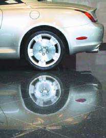 Use of RetroPlate System on black terrazzo at Lexus dealership in Portland, Ore.