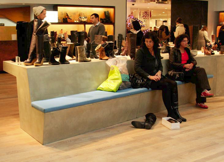 The countertops also have a built in bench for shoppers to try on shoes.