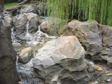 Realistic stream made of faux concrete rock.